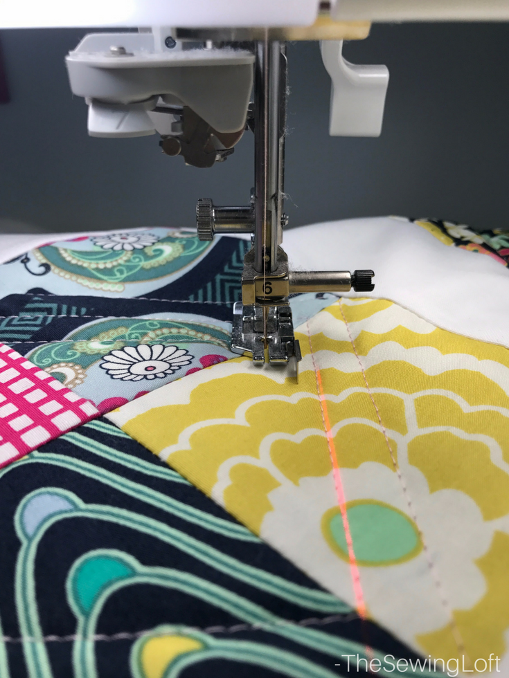 Straight quilting is beautiful and the laser beam guide makes it easy to keep your stitches straight.