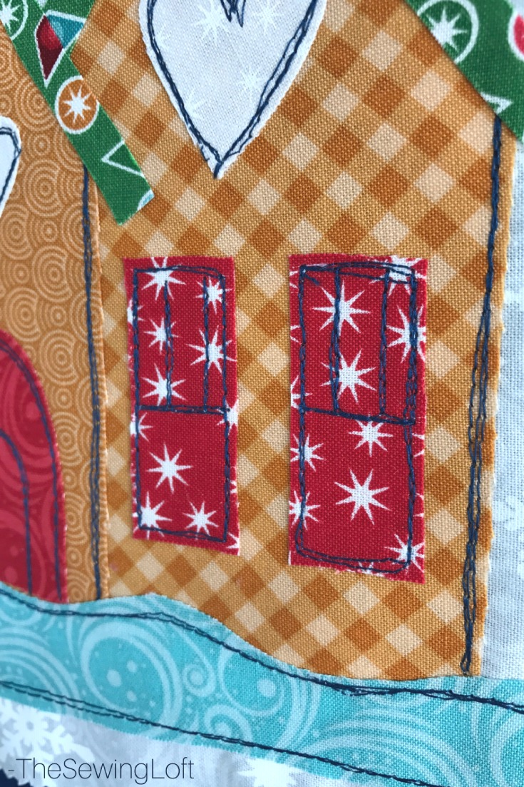 Each design element gave me an opportunity to outline the applique with my version of character. I even used a decorative stitch on my machine to accentuate the corner of the house.