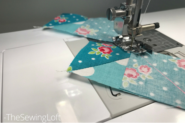 The laser beam guide makes it sew easy to create flying geese units needed for the devoted quilt block.