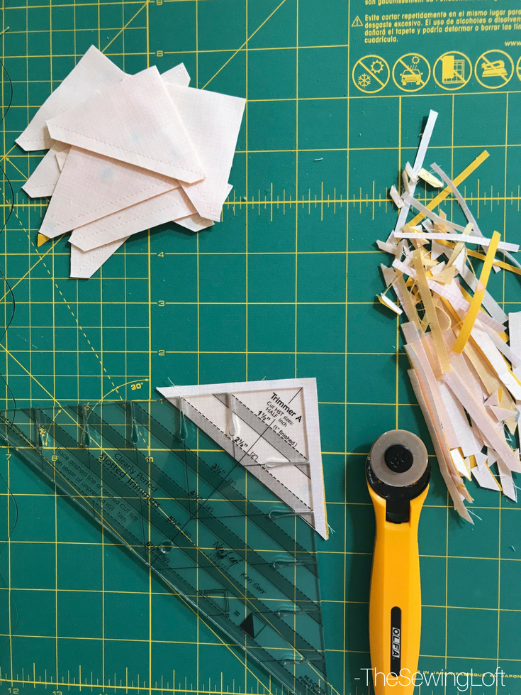 See how easy it is to make half square triangles with the clearly slotted ruler.