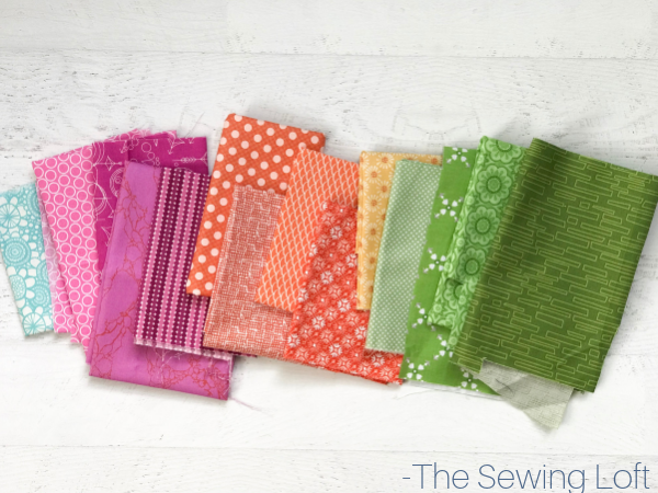 Head to your fabric stash, pull an assortment of your favorite colors and stitch up the Zinnia Flowers Quilt Block by The Sewing Loft