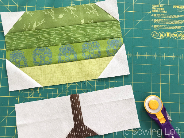 The simple patchwork construction of the Patchwork Tree quilt block makes it perfect for for quilters to play with their scraps.