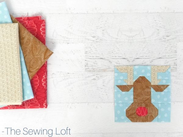 Keep the holiday spirit alive with this easy to make patchwork Rudolph Reindeer quilt block.  The Sewing Loft