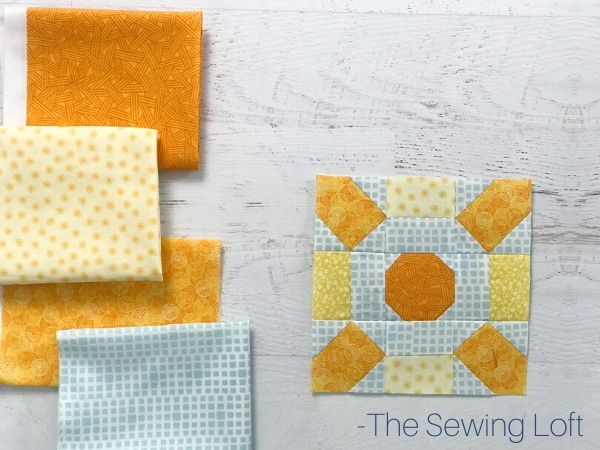 Pretty fabric scraps pulled to stitch up the Sunburst quilt block pattern by The Sewing Loft. Pattern is available in 2 sizes, is easy to make, and requires no special tools.